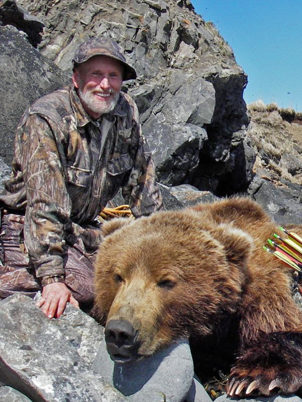 Bowhunting legend Jack Frost with a whopper brown bear.